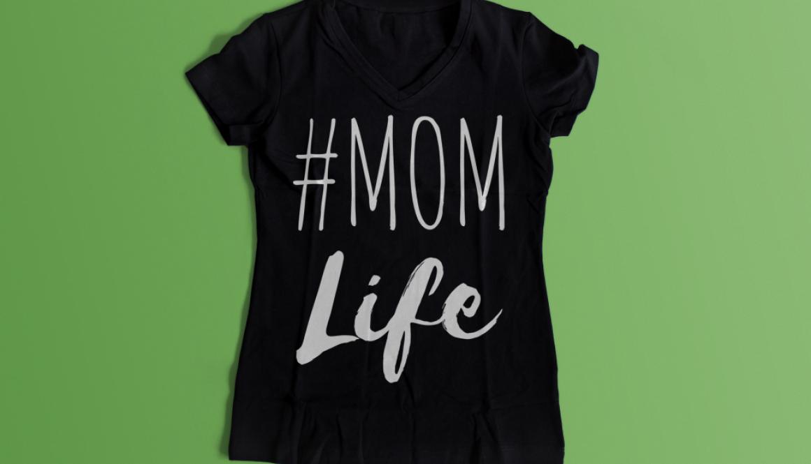 Black Tshirt says #MOM Life in white font
